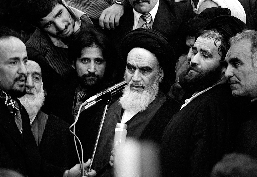 Ayatollah Khomeini addresses an audience in the airport building in Tehran, Iran, in this Feb. 1, 1979 file photo following his arrival from 14 years of exile. Crowds celebrate the 25th anniversary of the Islamic Revolution Wednesday Feb. 11, 2004.
